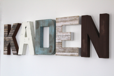 Rustic letters for a farmhouse style nursery or woodland nursery featuring distressed letters in brown, white, and blue colors.
