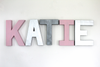 Girl name letters spelling out KATIE in pink, silver, and grey.