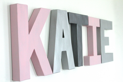 "Girl ""wooden"" and ""metal"" name letters spelling out KATIE."