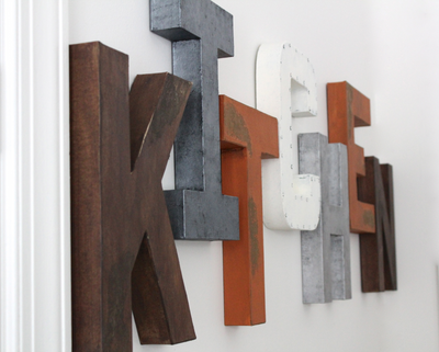 """Wooden"" and ""metal"" kitchen wall letters in different colors and styles."