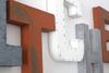 Silver, orange, and white rustic kitchen wall letters.