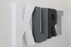Kurt custom wall letters in white, gray, black, and gray colors for modern kids room decor.