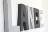 Grey theme nursery wall letters spelling out lance.