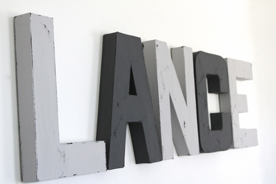 Monochromatic boy room letters spelling out the name LANCE.