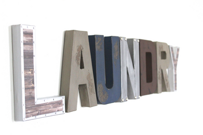 "Laundry wall sign in 8"" tall letters in different styles and finishes."