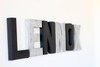 Modern letters spelling out the name Lennox.