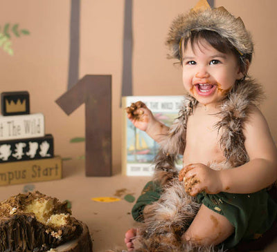 Smiling picture of baby boy with cake and picture prop wooden number 1