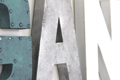 "Silver, blue, and white ""wooden"" and ""metal"" nursery wall letters."