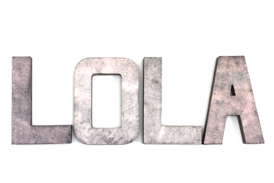 Rose gold girl nursery name letters spelling out LOLA.