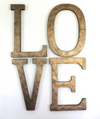 "Large bronze ""metal"" LOVE wall sign."
