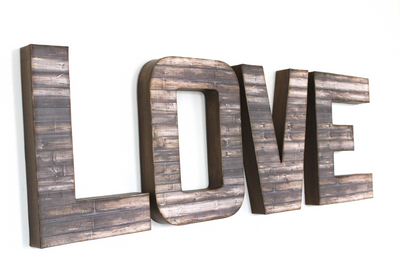 Rustic faux reclaimed wooden LOVE wall letters.