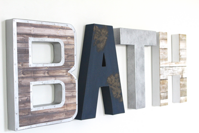 Bath wall letters created in an industrial farmhouse style in navy, white, and silver letters.