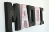 "MADDI wall name ""wooden"" letters in pink and black."