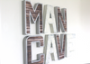 Industrial rustic farmhouse man cave wall letter sign for man cave wall decor with a nail trim design around each letter.