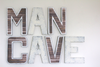 Rustic Industrial man cave wall sign with a nail trim design going around each letter.