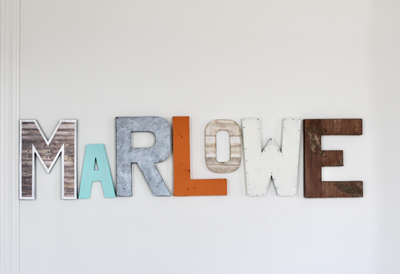 Marlowe baby name letters in aqua, orange, whites, and browns.