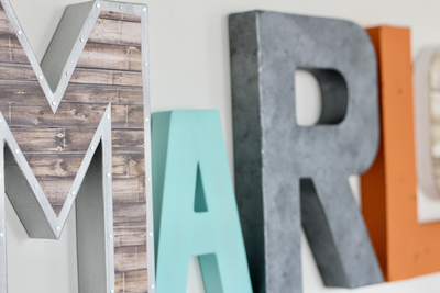 Baby name letters created with industrial and rustic styles.