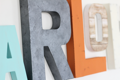 Industrial letter R and orange distressed letter L.