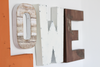 Rustic reclaimed wall letter O and industrial white letter W.