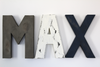 Baby boy nursery signs spelling out Max in different gray, white, and navy blue colors for baby boy nursery wall decor.