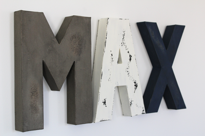 Distressed Wall Letters in Grey, White, and Navy for baby boy wall decor.