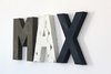 Custom Wall letters spelling out the name Max in different distressed colors for baby boy nursery decor.