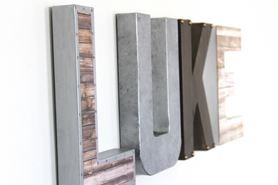 Boy name letters for nursery room wall decor spelling out the name LUKE in different colors and textures.