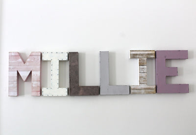 Girl wall letters for bedroom and nursery wall decor in pink, purple, and white.
