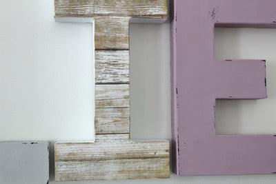 "Beach style wall letter I and purple lilac ""wooden"" letter E."