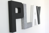 Playroom wall sign letters in black, white, and silver.