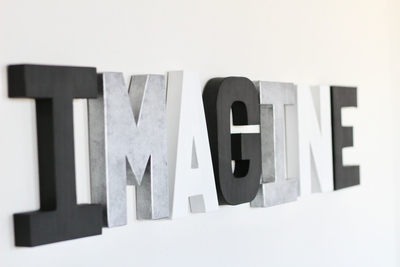 Imagine sign in modern colors like black, white, and silver.