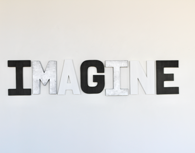Imagine sign for modern playroom decor.