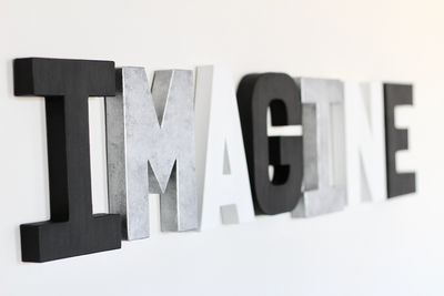 Imagine sign in modern black, white, and silver colors.
