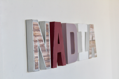 Nadia baby girl name sign.
