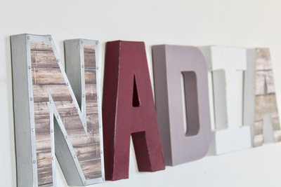 Baby girl nursery sign spelling out Nadia.