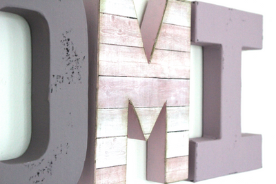 "Purple and pink reclaimed ""wooden"" letters."