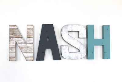 Nash modern farmhouse nursery letters in different textures and  colors.