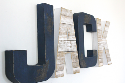 Nautical letters spelling out the name Jack in navy and white colors.