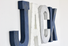 Baby name sign spelling out Jack for nautical nursery decor.