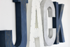 Jack nautical nursery letters in navy, white, and silver colors.