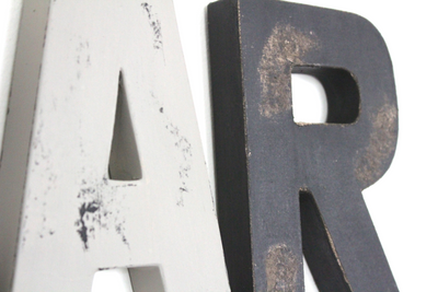 "Distressed ""wooden"" bar letters in different colors and styles."