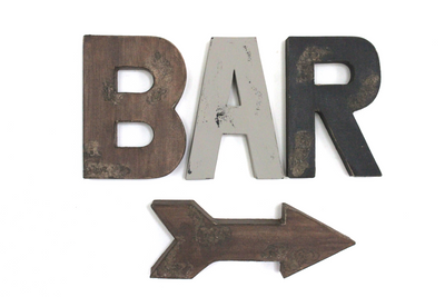 "Distressed ""wooden"" arrow with the word BAR on the wall."