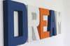 Nautical dream sign letters for nursery and playroom wall decor in different colors and textures.