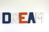 Dream sign for nautical nursery rooms in blue, orange, and white.