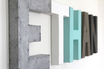 Boy name letters in silver, white, aqua, gray, and black spelling out the name Ethan.