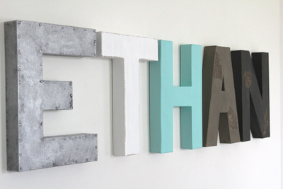 Ethan name sign for nursery wall decor and boy's room wall decor in silver, white, blue, gray, and black.