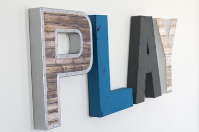 Play letters for boys playroom decor in brown, blue, gray, and white.