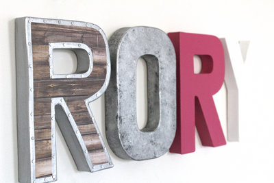 "Girl room wall letters in ""wooden"" and ""metal"" letters spelling out the girls name Rory."