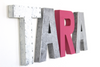 Pink, silver, and white room letters spelling out girl's name TARA.