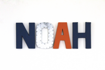 Camping themed nursery name letters spelling out NOAH in both industrial colors as well as bolder colors like navy and orange.